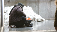 Anonymous female beggar Stock Footage