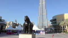 Dubai - Botero Horse Statue with Burj Khalifa in background zoom out Stock Footage