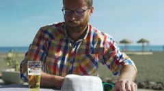 Pensive man drinking beer in the cafe and having problems Stock Footage