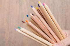 Bunch of pencil on wooden table unity concept of leadership, community, team  Stock Photos