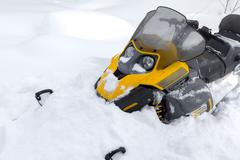 Snowmobile in snow. - stock photo