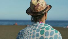 Woman walking on the sandy beach and relaxing, steadycam shot Stock Footage
