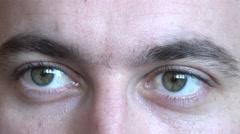 Man green eyes closeup, businessman rising an eyebrow, surprised, gesture, fun - stock footage