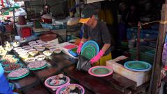 Sale of fresh seafood sets on the Jagalchi Fish Market. Busan, South Korea Stock Footage