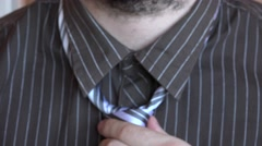 Close up man working on knot tie, elegance, business man wearing shirt, portrait - stock footage