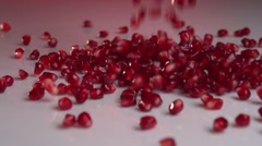 Garnet. Fresh pomegranate seeds falling. Slow motion 240 fps. Stock Footage