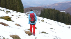 A man walking in the snowy mountain Stock Footage