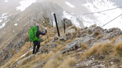 A man walking in the rocky mountain - stock footage