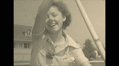 Vintage 16mm film, 1934, Ontario, Kawartha Lakes pretty girl paddling Stock Footage