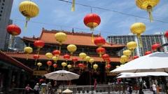 People pray at the Wong Tai Sin temple in Hong Kong, China. Stock Footage