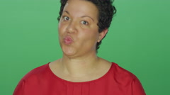 Woman makes a fish face and laughs, on a green screen background Stock Footage