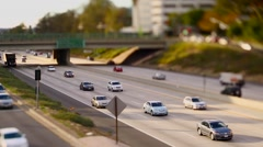 Freeway onramp as cars zoom by in california with a tilt shift focus lens. Stock Footage