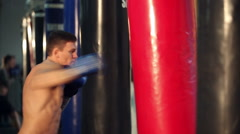 Man Exercising With the Punching Bag Stock Footage