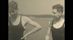 Vintage 16mm film, 1934, Ontario, Kawartha Lakes people on swim platform Stock Footage