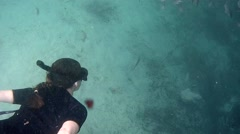 Woman Snorkeling in a crystal clear spring Florida USA Stock Footage