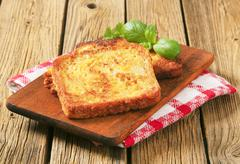 French toast - Bread soaked in beaten eggs and then fried - stock photo