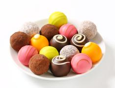 Assorted chocolate truffles and fruit ganache pralines - stock photo