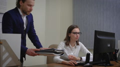 Boss gives a task to the Secretary girl. Senior business woman in a white blouse Stock Footage