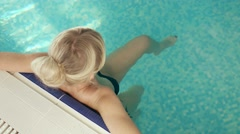 Slim blonde in the swimming pool Stock Footage