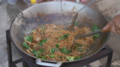 Stir fried rice noodle in pan (Korat stir fried noodle, Thailand food) - stock footage