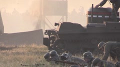 A German soldier throwing a grenade at a Russian tank - stock footage