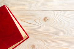 Red book on wooden table. Top View. Back to school. Copy space - stock photo