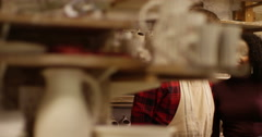 Portrait of a happy cheerful couple in their pottery studio. Slow motion. Stock Footage