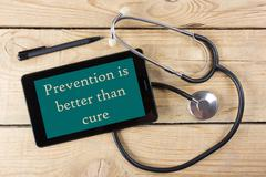 Prevention is better than cure - Workplace of a doctor. Tablet, medical - stock photo