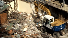 Backhoe loader working in construction site Stock Footage