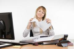 Business girl having fun tearing the paper document Stock Photos