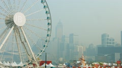 Observation wheel and amusement parm in Central Hong Kong Stock Footage