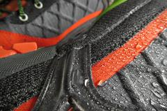 Waterproof technology for mountain shoes Stock Photos