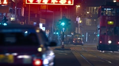 Night urban scene with taxi cars and trams Stock Footage