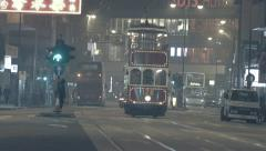 Traditional vintage small wooden trams moves on central Hong Kong street Stock Footage