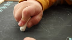 Little boy draws on a chalkboard Stock Footage