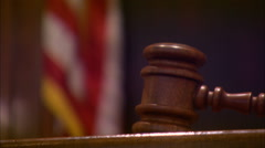 Closeup of Judge Hitting Gavel in Courtroom with US Flag In Background HD Video Arkistovideo
