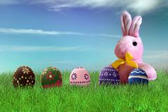 Painted Easter eggs and pink bunny Stock Photos