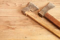 Two dated and used cleavers on wooden background - stock photo