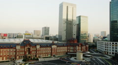 Elevated View of Tokyo Station with High-Rise Buildings late Afternoon - stock footage