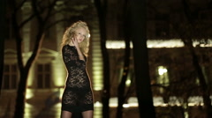 Silhouette of hot sexy girl in black lace underwear posing in the dark under - stock footage