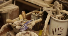 Tools used in pottery design lying out on a workbench. Stock Footage