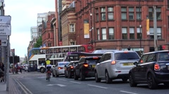 4K Amazing traffic street Manchester old town commuter transportation congestion Stock Footage
