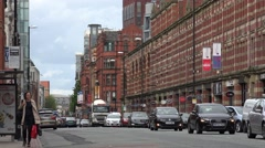Stock Video Footage of 4K Public transportation bustling avenue Manchester town local UK shop sign day