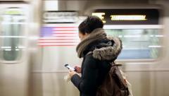 Woman Checking Smartphone on New York Subway Platform Stock Video Stock Footage
