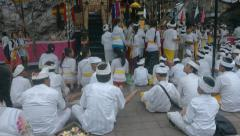 Worshipers in white traditional temple clothes take a part in sacred service Stock Footage