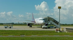 Airliner on tarmack, with an accomodation ladder at Airport Stock Footage