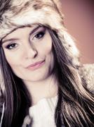 Woman in fur cap - stock photo