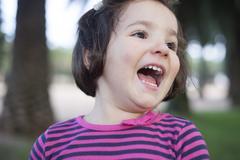 Euphoric three years old little girl. - stock photo