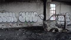 Packard Plant: Detroit Ruins Burned Car inside Building - stock footage