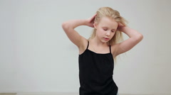 Young girl shows the various model poses Stock Footage